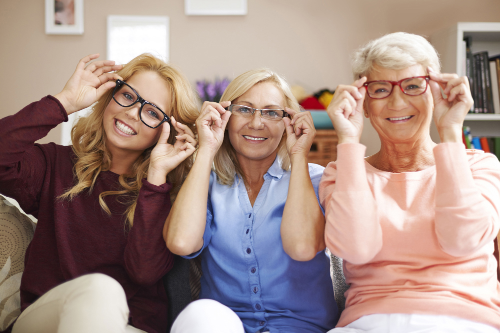 women sitting on couch with glasses on